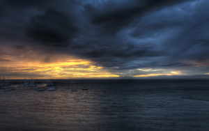 Dark-Clouds-Over-Ocean-Wallpaper